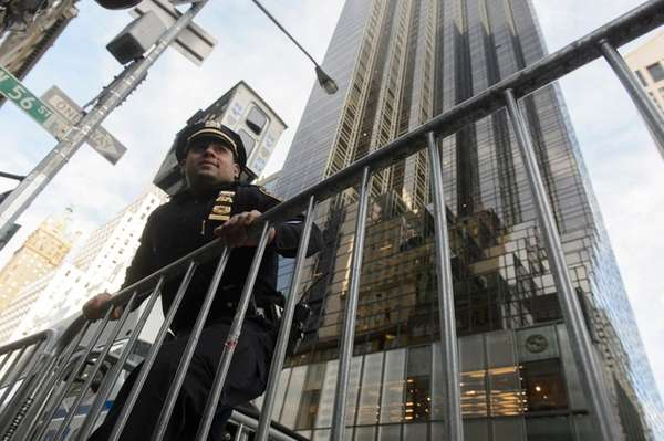 An NYPD officer leans on a barricade Monday,