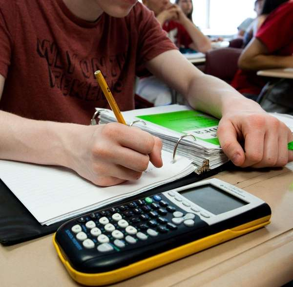 Algebra students prepare for a Regents exam in