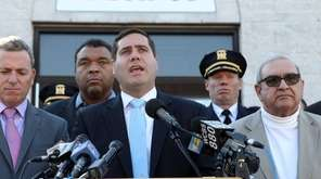 Suffolk County Police Commissioner Timothy Sini, center with