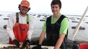 Oyster farmers Matt Beitman, left, and Jake Kitchener.