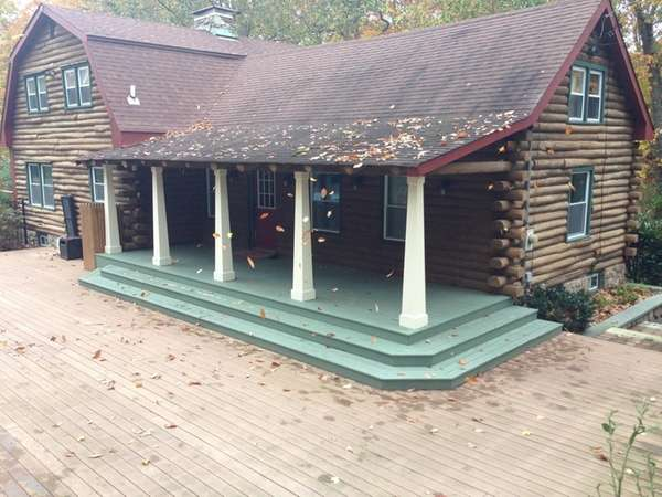This Miller Place log cabin is listed for