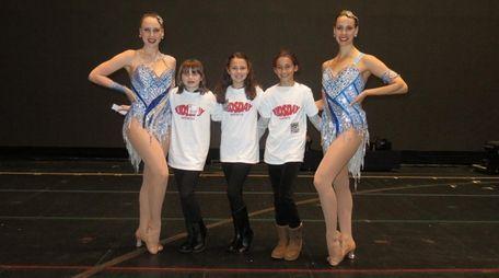Rockettes Jennifer Clavin, left, and Kristin Jantzie with