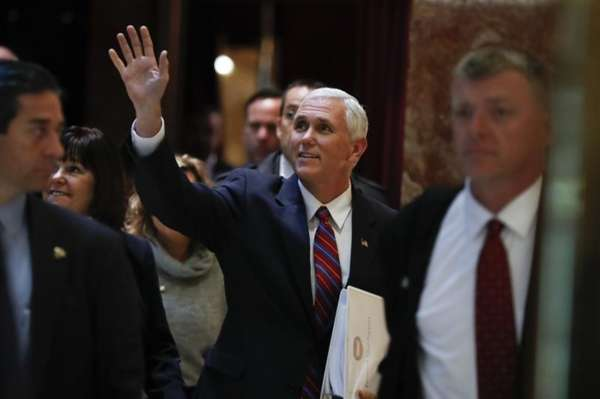 Vice President-elect Mike Pence waves as he arrives