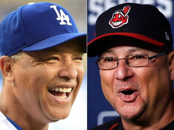 The Dodgers' Dave Roberts, left, and the Indians'
