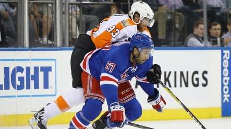 The Rangers' Cristoval Nieves, here being marked by
