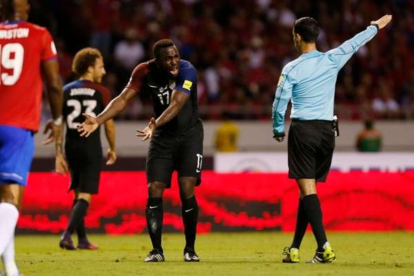The United States' Jozy Altidore, center, protests to