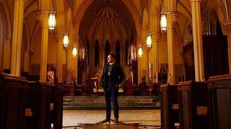 The Very Rev. Michael Sniffen inside of the