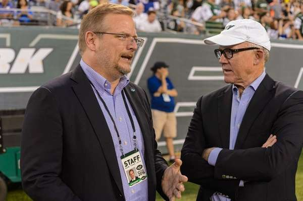 Jets general manager Mike Maccagnan and owner Woody