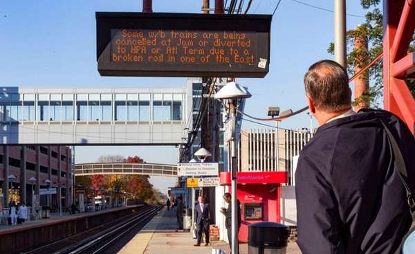 LIRR commuters wait at the Mineola station as