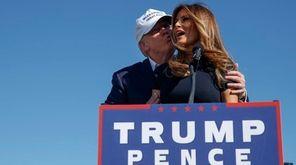 Republican presidential candidate Donald Trump, left, kisses his