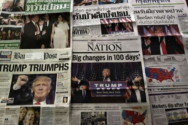 This photo illustration depicts Thai newspapers on November