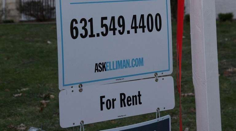 A for rent sign on a house on
