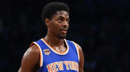 New York Knicks guard Justin Holiday looks on