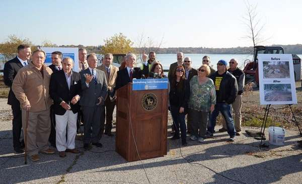 Flanked by local community leaders and elected officials,