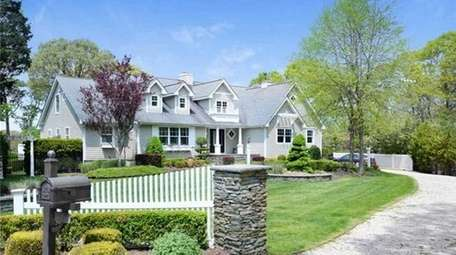 This waterfront Center Moriches Traditional with five bedrooms