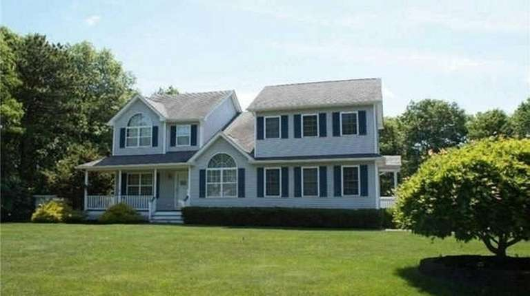 This Center Moriches Colonial with four bedrooms is