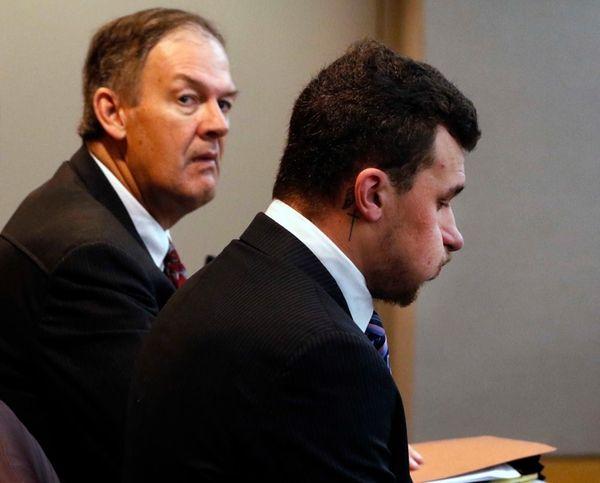 Defense attorney Jim Darnell, left, waits with Heisman