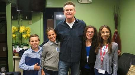 Comedian Brian Regan with Kidsday reporters from left,