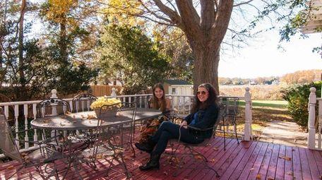Jean DeAngelis and her daughter, Ann, 18, sit