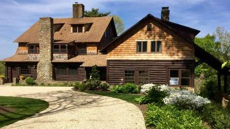 This 1903 Laurel Hollow log cabin, listed in