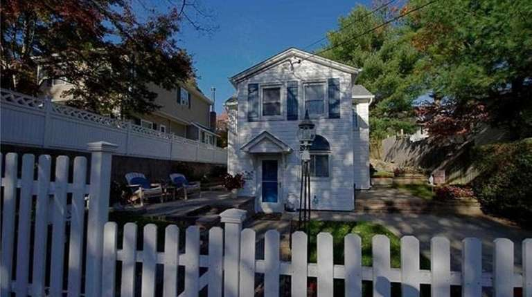 This two-bedroom, one-bath Sound Beach bungalow is listed