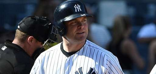 Brian McCann reacts after he strikes out against