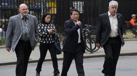 Chinese billionaire Ng Lap Seng, center, arrives at