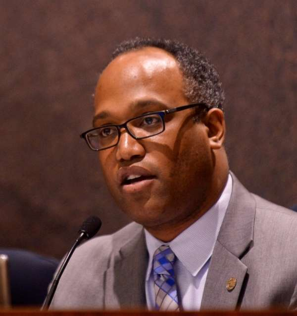 Presiding Officer Duwayne Gregory speaks as members of