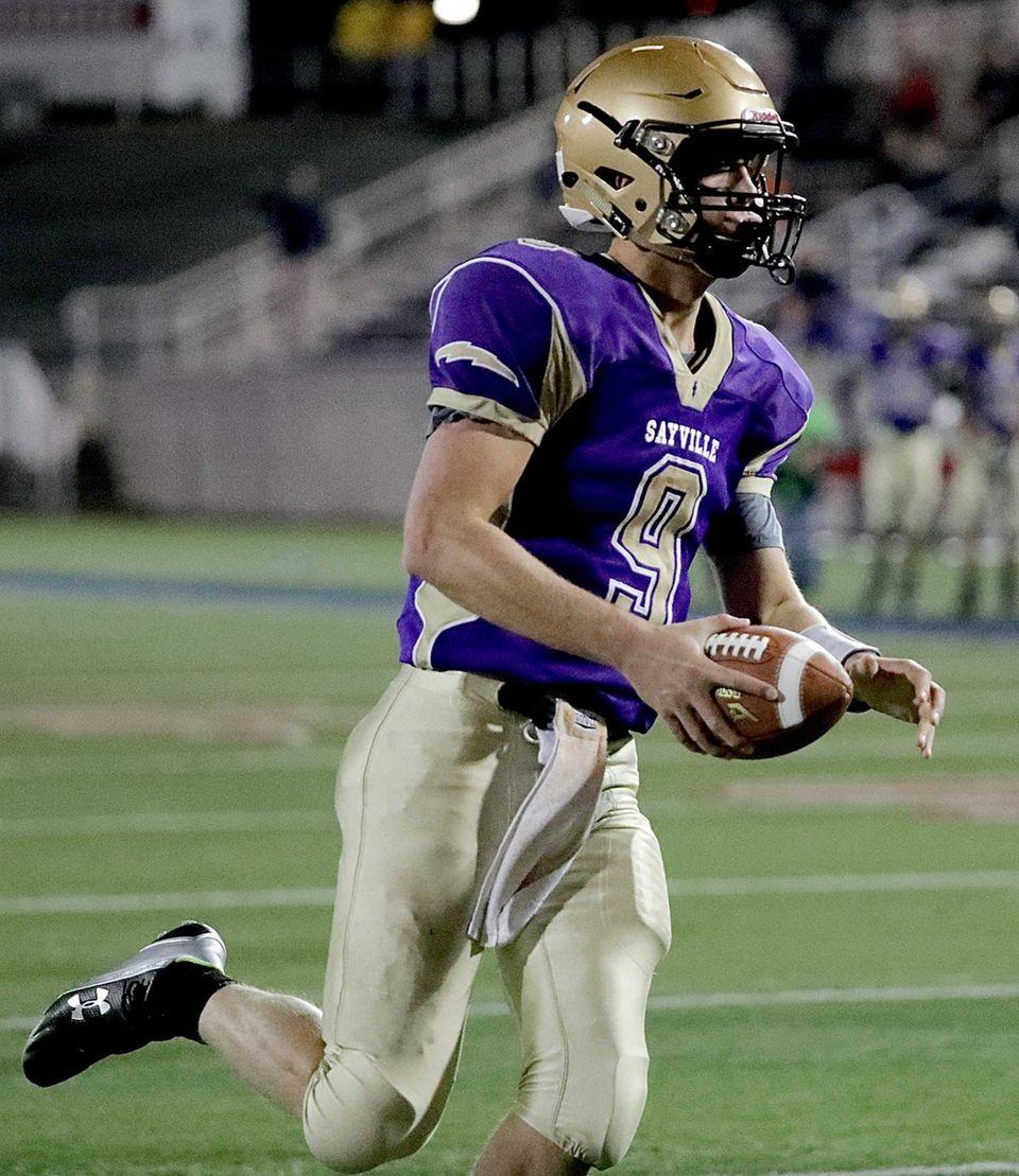 Sayville quarterback Jack Coan (9) on the keeper