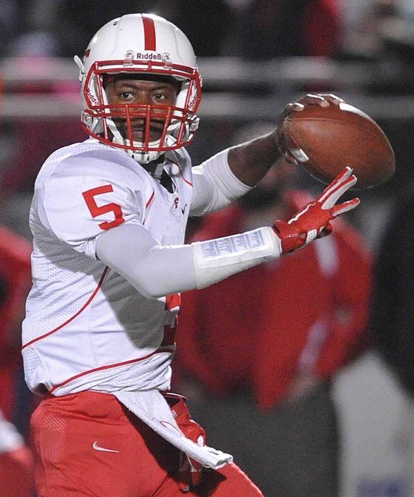 Freeport quarterback Rashad Tucker #5 throws a pass