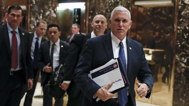 Vice President-elect Mike Pence leaves Trump Tower, Thursday,