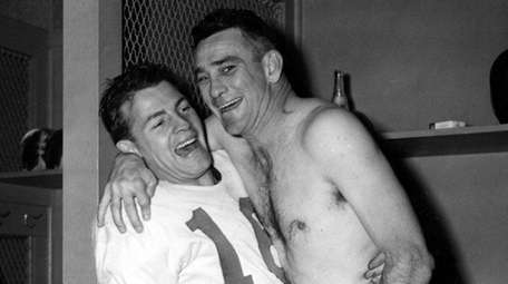 Giants quarterback Charley Conerly, right, and halfback Frank