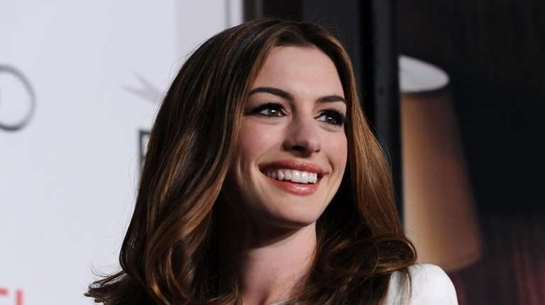 Photos of Anne Hathaway through the years.