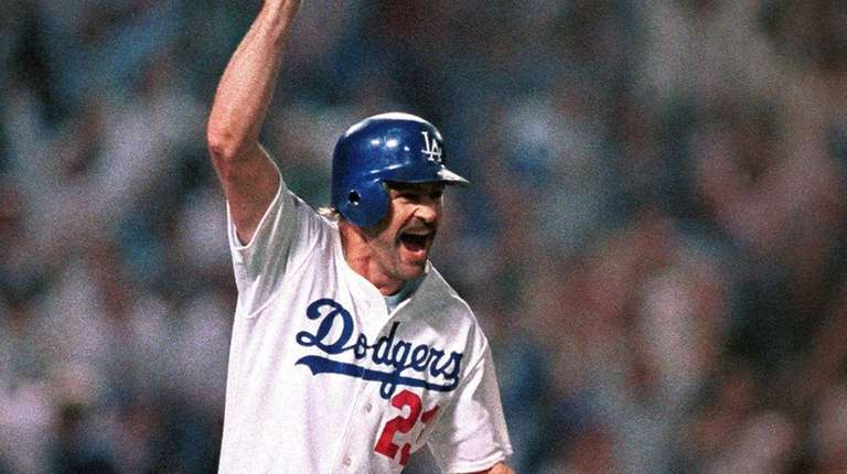 Los Angeles Dodgers' Kirk Gibson celebrates as he