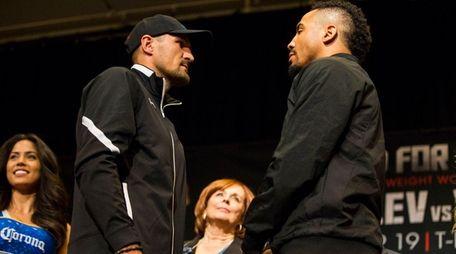 Sergey Kovalev, left, and Andre Ward pose for