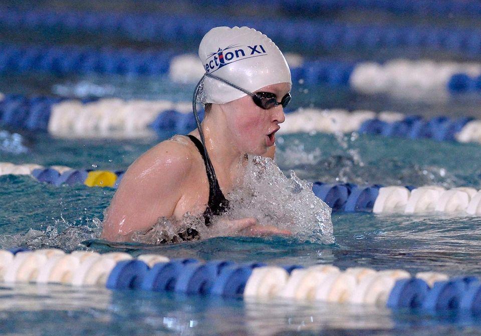 Ward Melville's Riley Gavigan swims in a preliminary