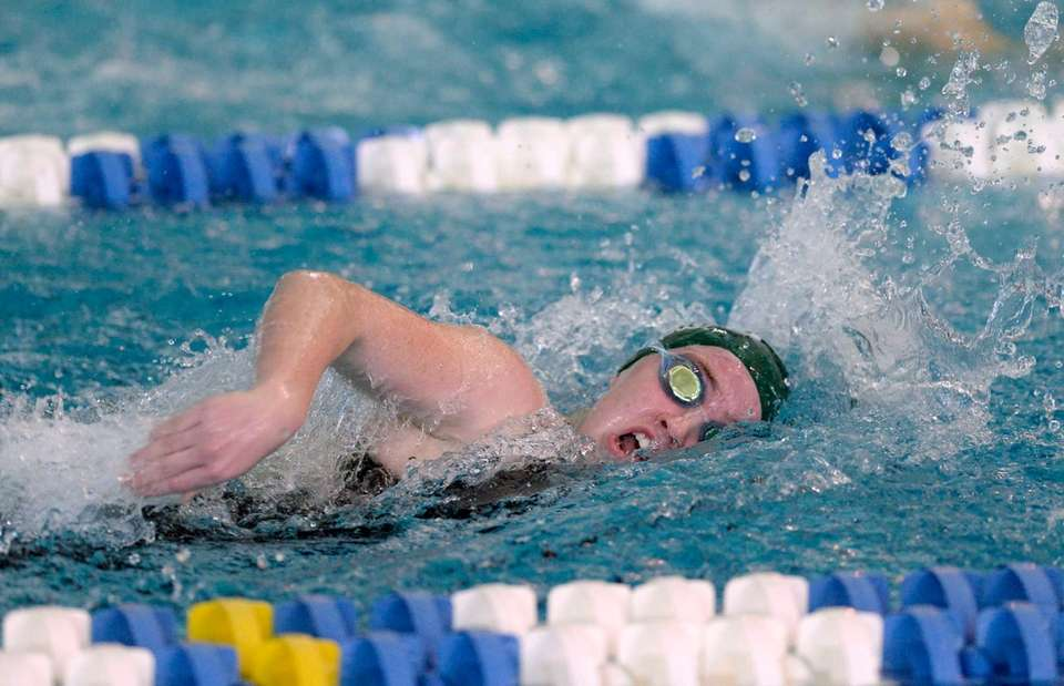 Garden City's Elizabeth Fetherston swims in a preliminary
