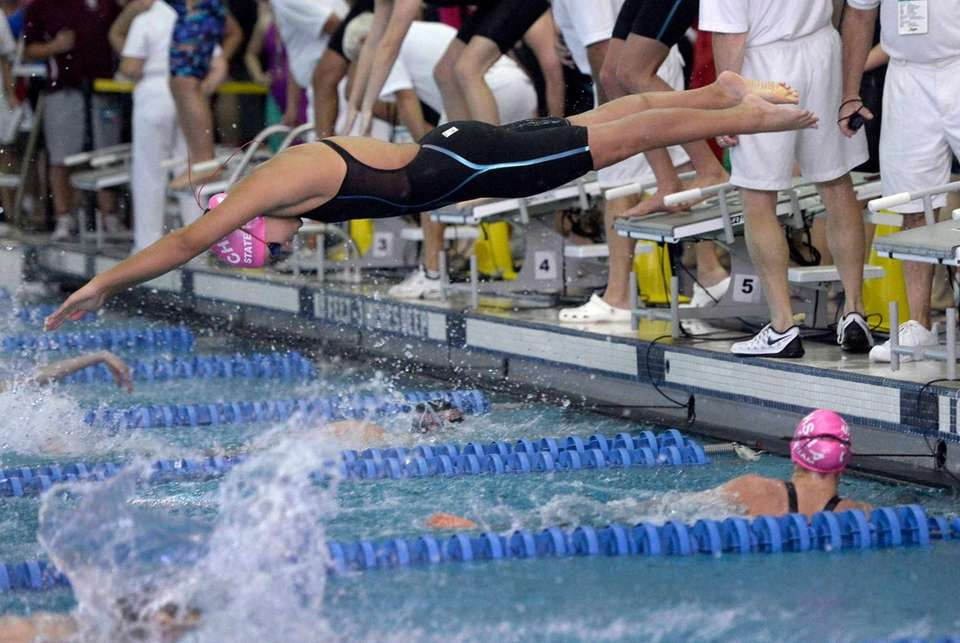 St. Anthony's Briana Gellineau dives over teammate Emily