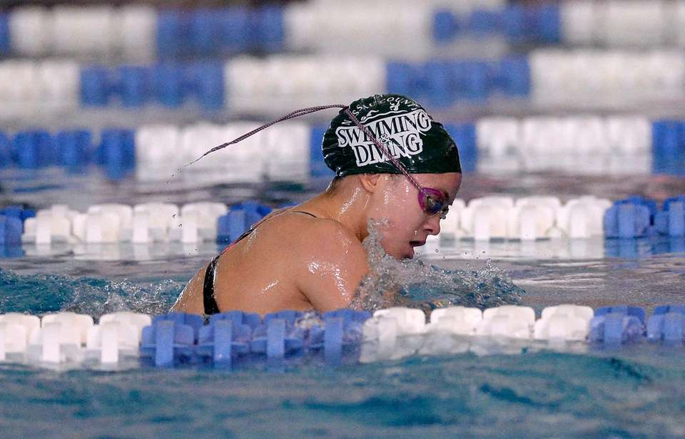 Manhasset's Claire McNeary swims in a preliminary heat