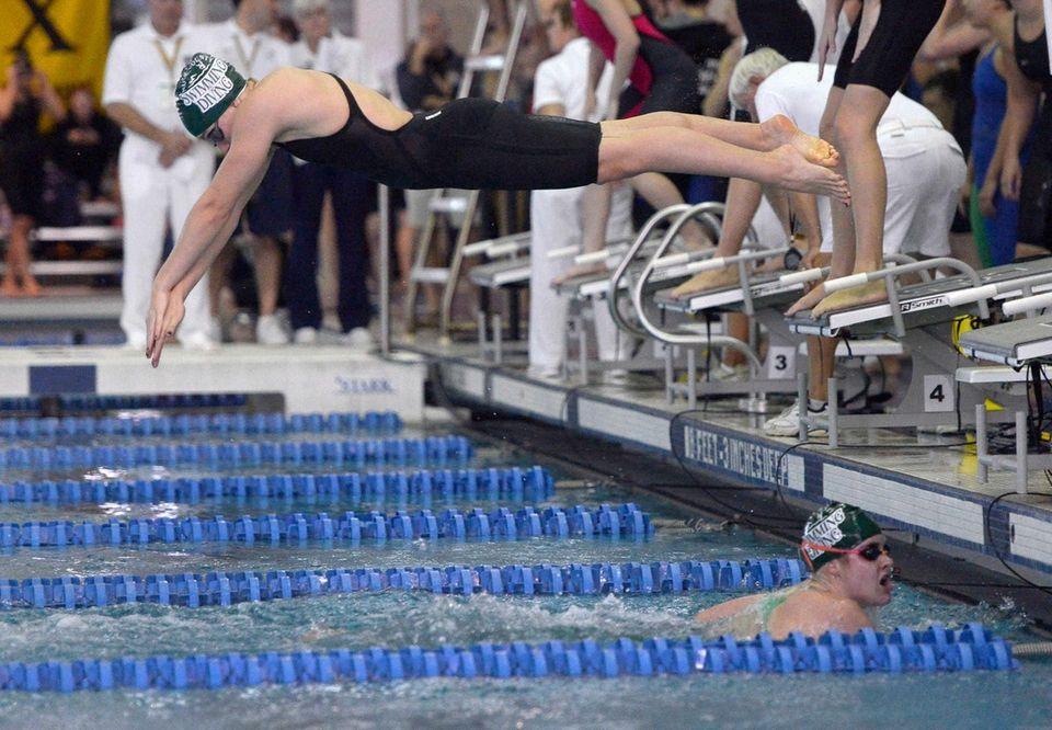 Long Beach's Margaret Aroesty dives over Caroline Farrell