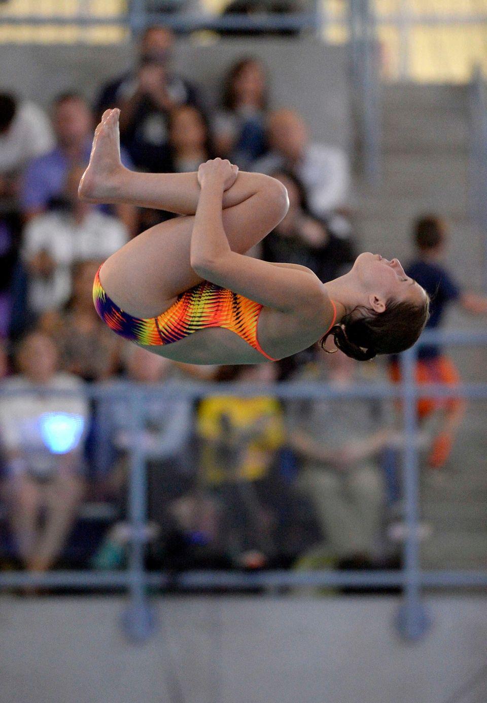 Sayville-Bayport-Blue Point's Megan Romano performs a dive during