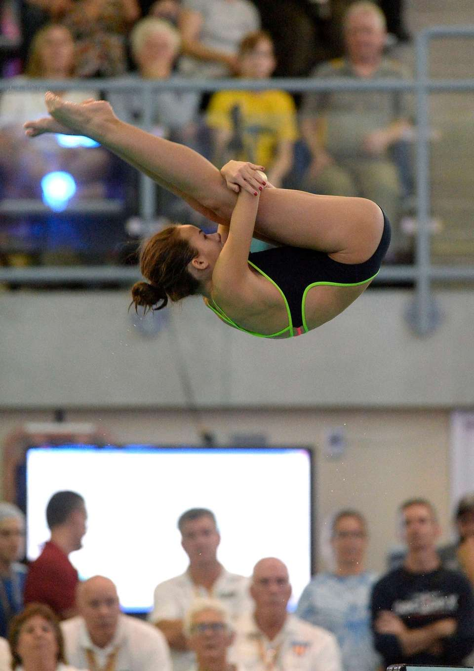 Cold Spring-Harbor's Camille Roberts performs a dive during