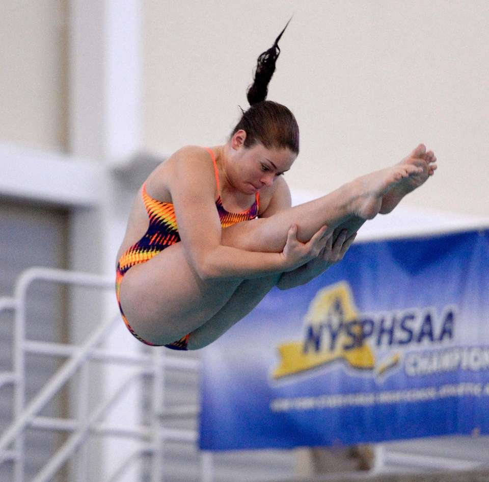 Hauppauge's Emma Casey performs a dive during the