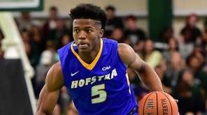 Hofstra guard Eli Pemberton (5) drives to the