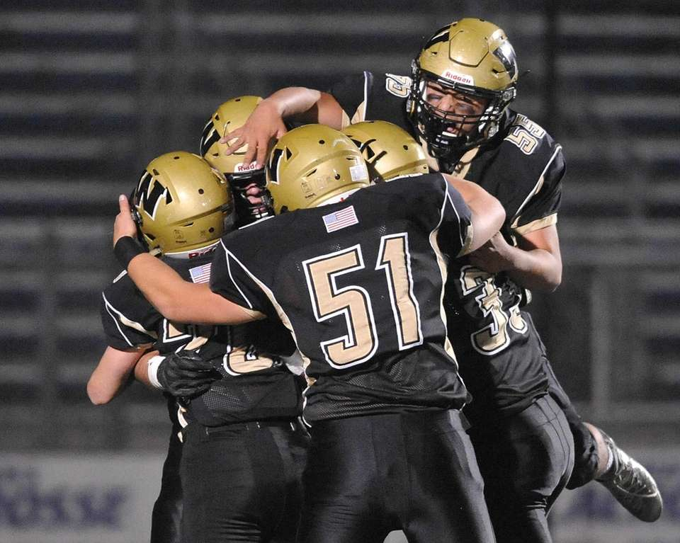 Wantagh teammates celebrate after a 29-yard rushing touchdown