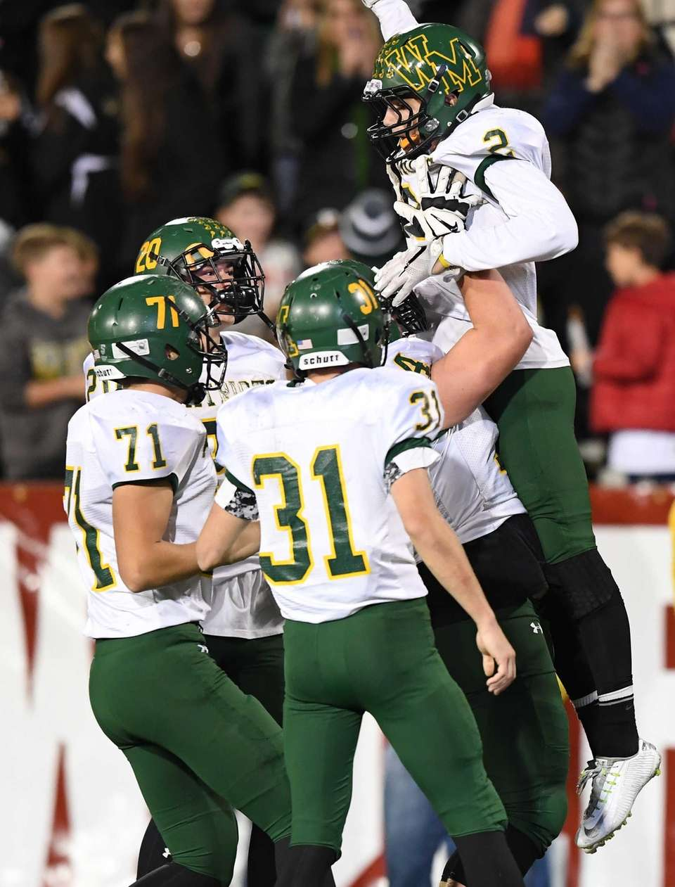 Ward Melville's Dominic Pryor celebrates his touchdown with