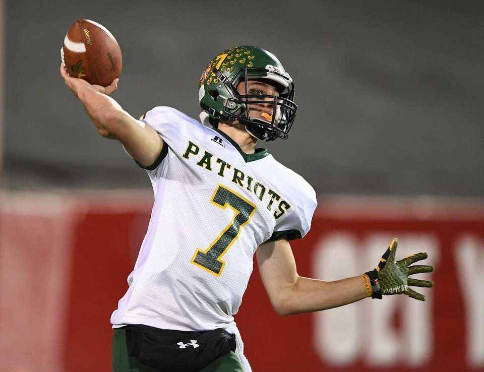 Ward Melville quarterback Wesley Manning passes against William