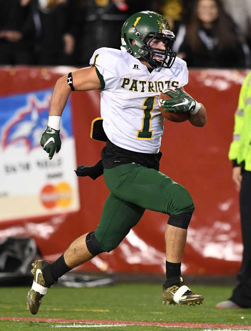 Ward Melville's John Corpac rushes for a touchdown
