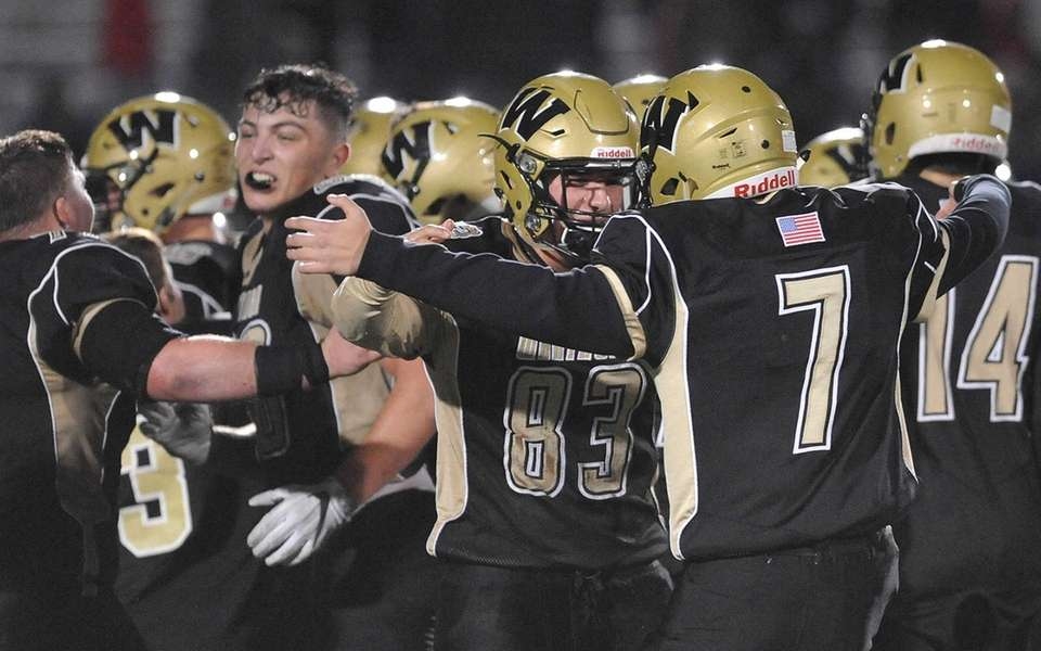 Wantagh teammates celebrate after their win against Roosevelt