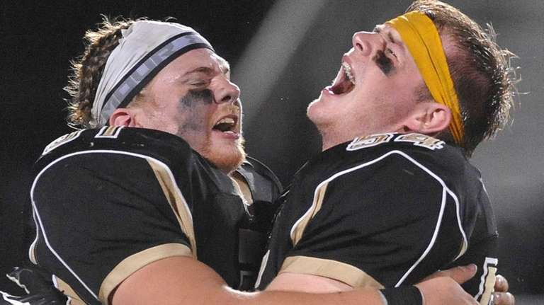 Wantagh teammates Sean Colbert #51, left, and Billy
